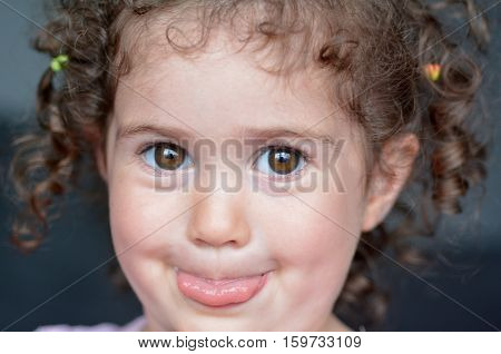 Child Sticking A Tongue Out