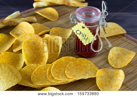chips with spicy sauce on the table.