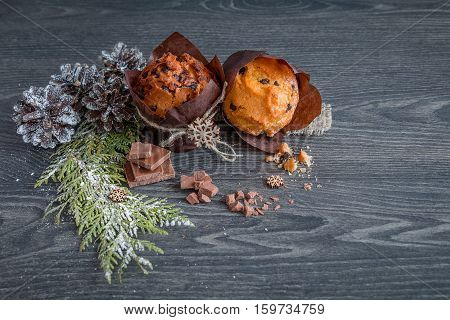 muffin on wooden table in the cones and the fir