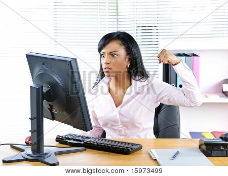Angry Black Businesswoman At Desk
