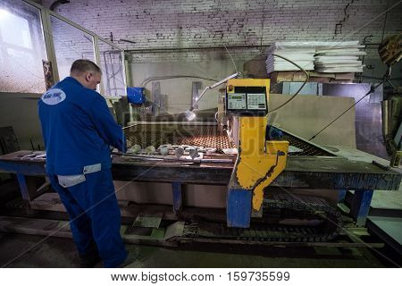 Milling Specialist Working For Waterjets Of Metal In The Shop At An Engineering Plant.