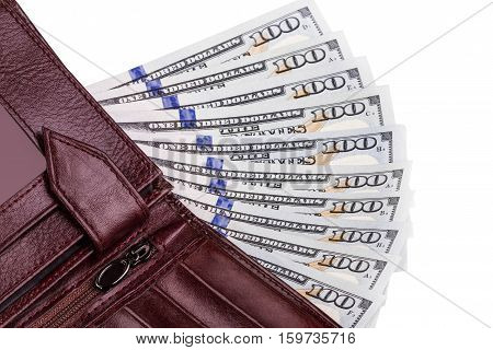 a few hundred dollar bills in a wallet on a light background