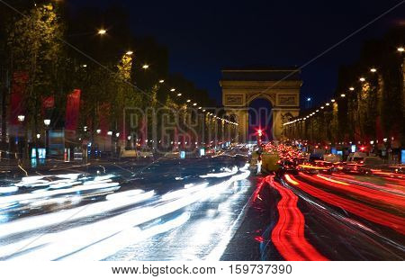 Night View Of The Champs-elysees And The Arc De Triomphe In Paris, France