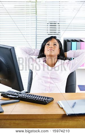 Black Businesswoman Resting At Desk