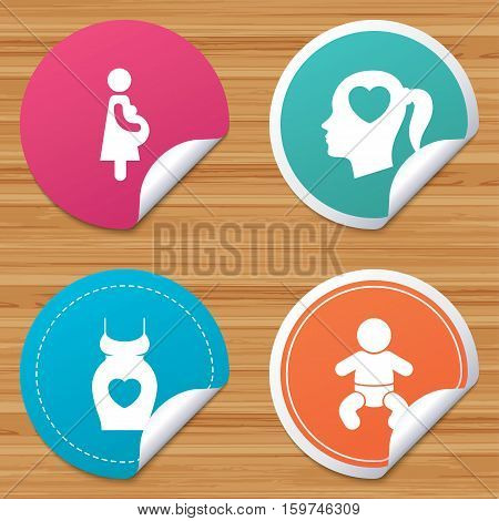 Round stickers or website banners. Maternity icons. Baby infant, pregnancy and dress signs. Head with heart symbol. Circle badges with bended corner. Vector