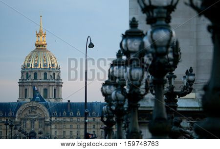 Dome Of The Invalides Cathedral In Paris Through Lanterns Of The Pont Alexandre Iii