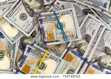 Heap of money in dollars cash banknotes on surface