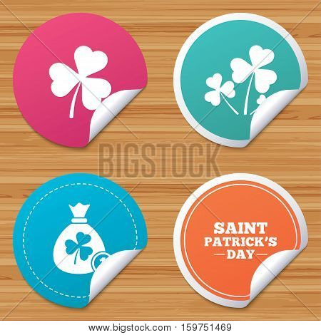 Round stickers or website banners. Saint Patrick day icons. Money bag with clover and coin sign. Trefoil shamrock clover. Symbol of good luck. Circle badges with bended corner. Vector