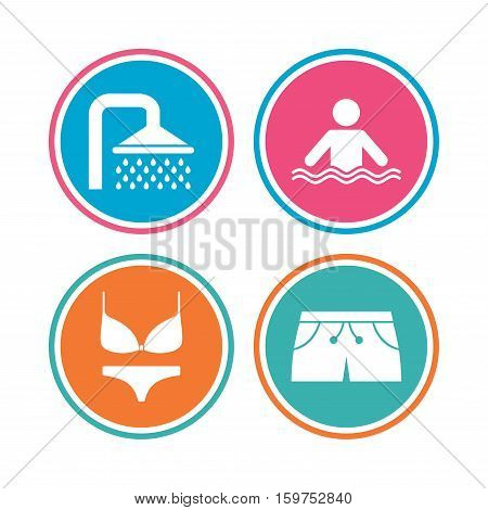 Swimming pool icons. Shower water drops and swimwear symbols. Human stands in sea waves sign. Trunks and women underwear. Colored circle buttons. Vector