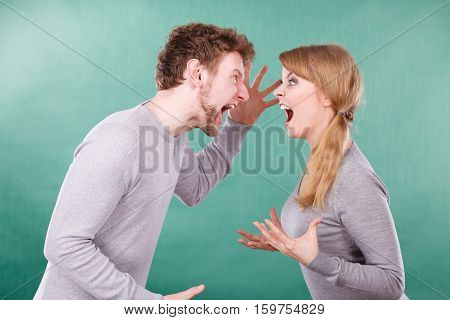 Husband And Wife Yelling And Arguing.