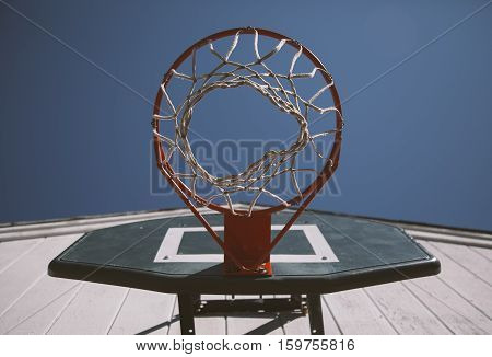 outdoor low angle image of basketball hoop