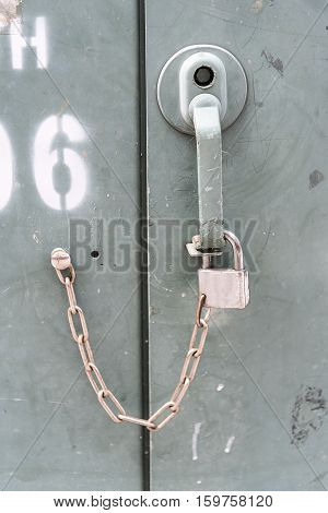 Close up key of rusted old lockers