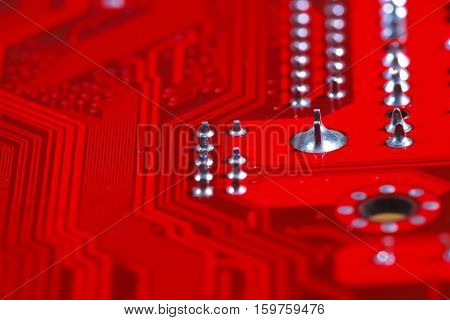 Closeup Of Red Electronic Motherboard Circuit With Processor
