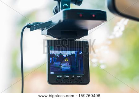 Car video recorder installed on a rear view mirror