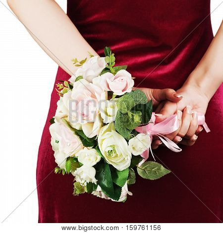 Beautiful wedding bouquet from white and pink roses in hands of bride.