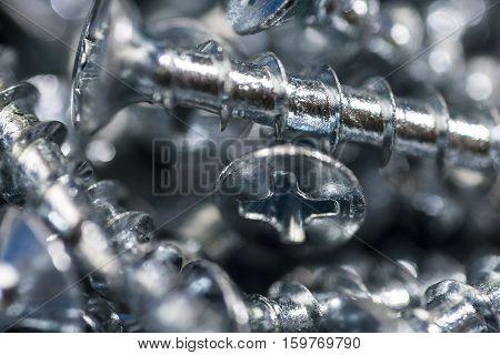 Silver Screws Macro Close Up. Background Pattern.