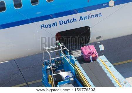 Amsterdam, Netherlands - August 17, 2016: Loading Luggage In Airplane At Amsterdam Schiphol Airport,