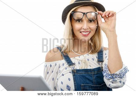 A beautiful blond middle-aged woman with tablet