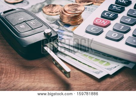 Key From The Car And Calculator On Money.