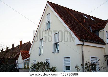 Single family house in Munich blue sky white facade