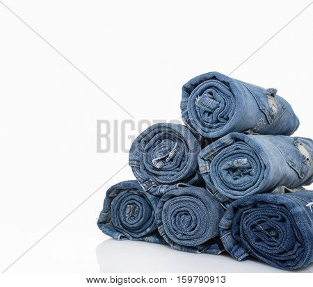 stack with roll blue denim jeans arranged in stack