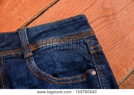 Close up of blue jeans ,Blue Jeans texture on wooden background