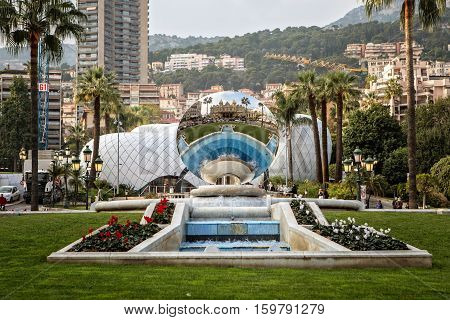 Monte Carlo Monaco - November 4 2016: Reflection of the Monte Carlo Casino in the Sky Mirror sculpture by Anish Kapoor in Monte Carlo Monaco.