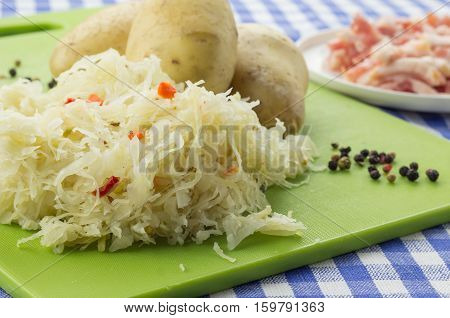 Ingredients For Typical Dutch Dish Zuurkool With Sauerkraut And Potatoes
