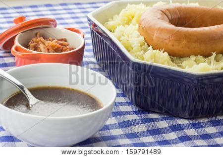 Typical Dutch Dish Zuurkool With Sauerkraut, Smoked Sausage And Gravy