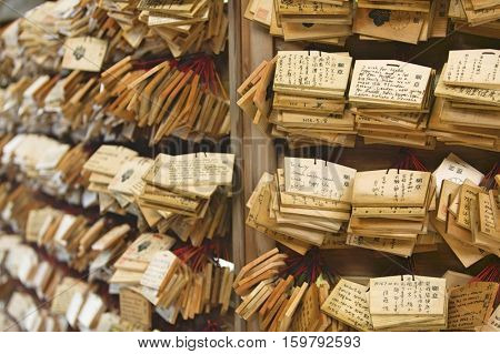 Japan, Tokyo, Meiji-jingu Shinto Shrine, Small wooden plaques with prayers and wishes (Ema)