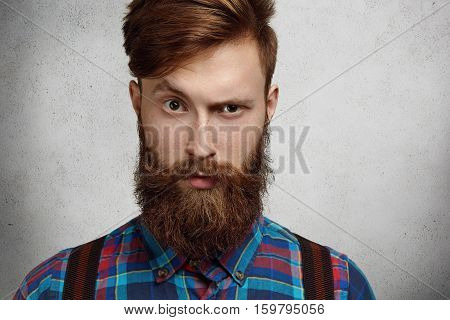 Portrait Of Masculinity. Stylish Fashionable Brunette Man With Trendy Beard Wearing Flannel Checkere