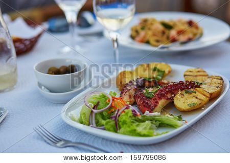 Grilled Octopus With Baked Potatoes