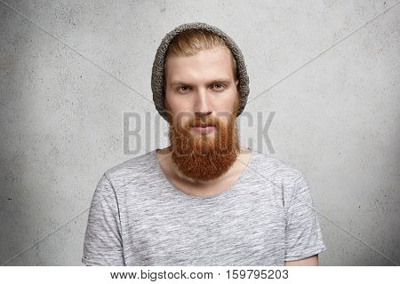 People, Style And Fashion. Good-looking Fashionable Funky Bearded Man Wearing T-shirt And Knitted Hi