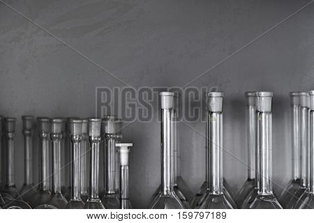 Scientific flasks displayed against white wall in laboratory