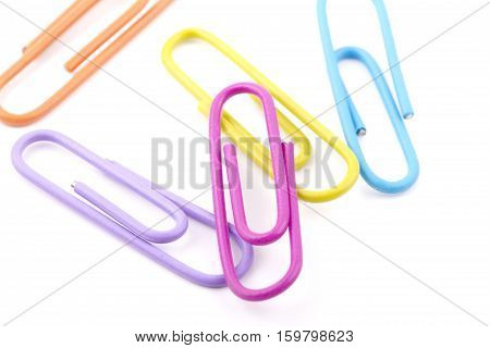 Colorful paper clips isolated on white background.