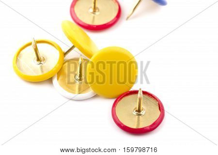 various pushpins isolated on white background .