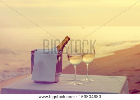 A romantic restaurant table on a beach at dusk