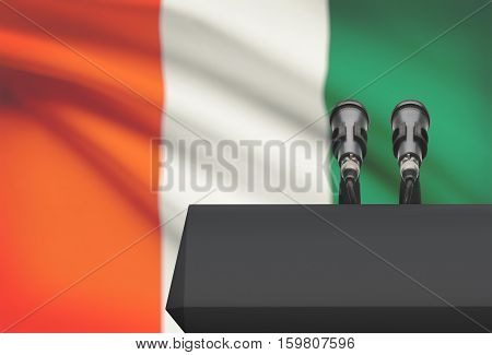 Pulpit And Two Microphones With A National Flag On Background - Ivory Coast