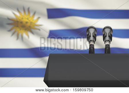 Pulpit And Two Microphones With A National Flag On Background - Uruguay