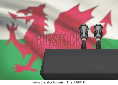 Pulpit And Two Microphones With A National Flag On Background - Wales