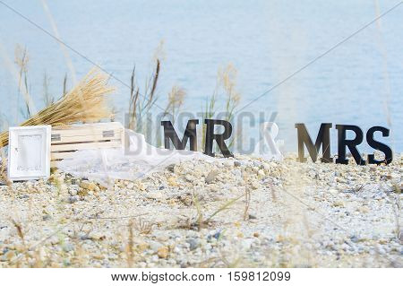 text Mr and Mrs standing outdoor and the green lake