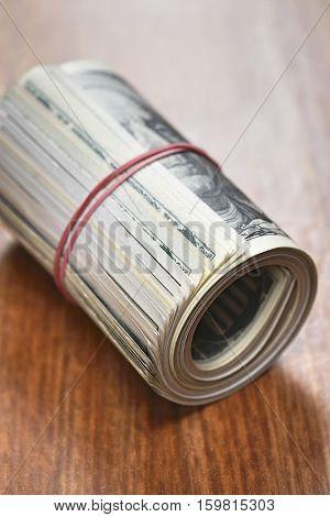 Roll of dollar bills, close-up