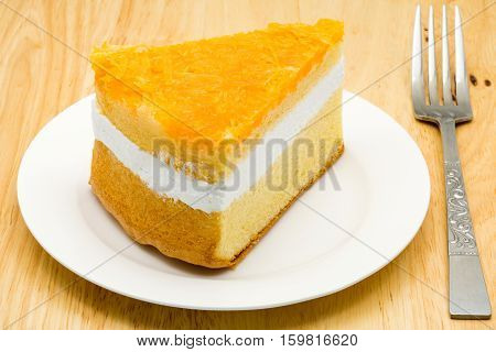 Foi thong cake in a white plate on a wooden board