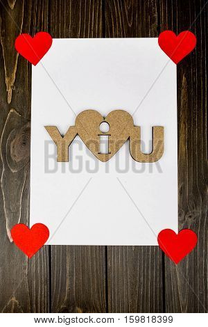 White Sheet And Red Hearts Lying On Wooden Surface