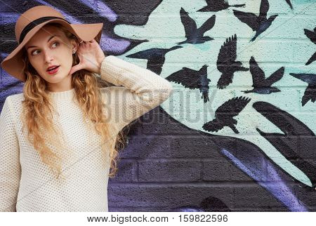 Portrait of a beautiful graceful woman in elegant hat with a wide brim. Beauty, fashion concept.