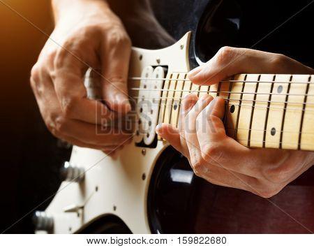 Man Playing Guitar. Close-up View