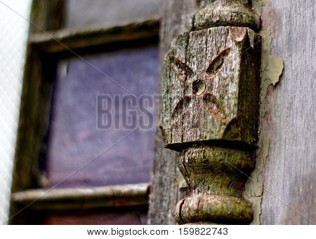 Weathered antique architectural wooden detail with chipped paint and stained glass