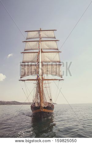 old historical ship (yacht) with white sails sailing in the sea
