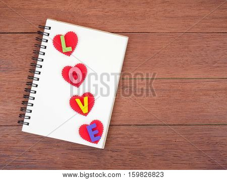 Colorful words Love made from wooden letters on wood background (Valentines day)