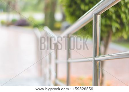 stainless steel railing walkway in gardenselective focus.